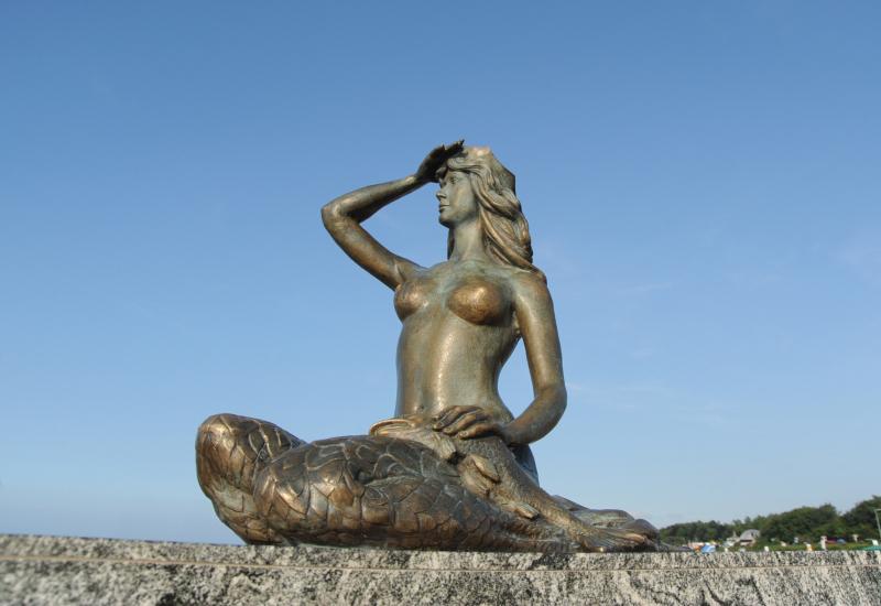 The Ustka Mermaid in Ustka Harbor.  Photo © Lokalna-Organizacja-Turystyczna-Ustka-i-Ziemia-Slupska
